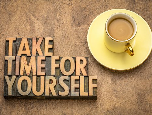 take time for yourself advice - inspirational text in vintage letterpress wood type with a cup of coffee, self care concept