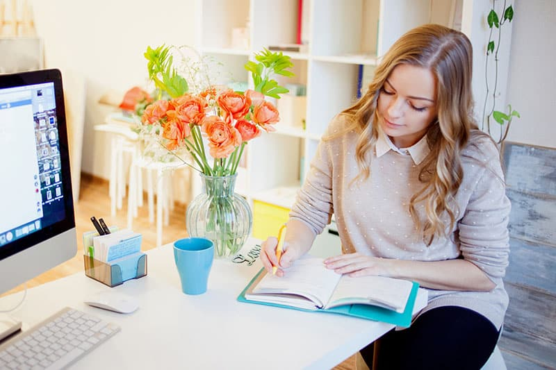 Young businesswoman sitting at desk and working.